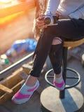 Woman drinking coffee in sun sitting outdoor in sunshine light enjoying her morning coffee Stock Photo