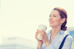 Woman drinking coffee in sun standing outdoor Royalty Free Stock Photos