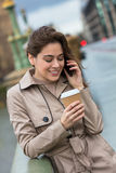 Woman Drinking Coffee Talking on Cell Phone, London, England Stock Photos