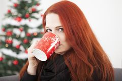 Woman is drinking coffee or tea on christmas Royalty Free Stock Photos
