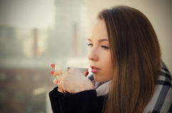 Woman drinking coffee or tea with cup on the balcony Stock Photography
