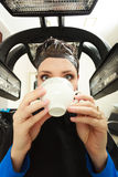 Woman drinking coffee tea in hair beauty salon. By hairdresser. Stock Photography