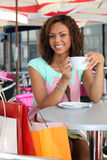 Woman is drinking coffee Stock Photo