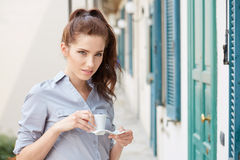 Woman drinking coffee at terrace on a morning Royalty Free Stock Image