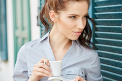 Woman drinking coffee at terrace on a morning Royalty Free Stock Photos