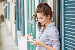 Woman drinking coffee at terrace on a morning Royalty Free Stock Photography
