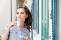 Woman drinking coffee at terrace on a morning Stock Image