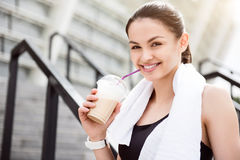 Woman drinking coffee after training Royalty Free Stock Photo