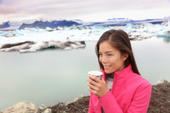 Woman drinking coffee on travel trip on Iceland Royalty Free Stock Photos