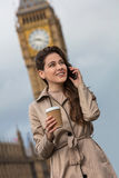 Woman Drinking Coffee Using Cell Phone, Big Ben, London, England Royalty Free Stock Photo