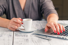 Woman drinking coffee and using digital tablet in the morning Royalty Free Stock Image