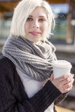 Woman drinking coffee while she waiting for the train Royalty Free Stock Images