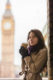 Woman Drinking Coffee by Westminster Bridge, Big Ben, London, En Royalty Free Stock Photography
