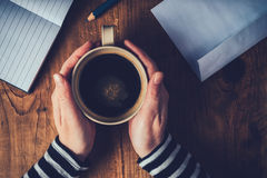 Woman drinking coffee and writing letters Royalty Free Stock Photos