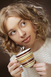 Woman drinking coffee. Young pretty woman drinking coffee Royalty Free Stock Photo