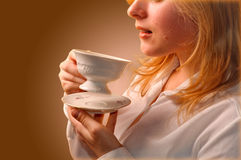 Woman drinking coffee. Young pretty woman drinking coffee Royalty Free Stock Images