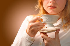 Woman drinking coffee. Young pretty woman drinking coffee Stock Photography