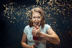 Woman drinking a cola stock images