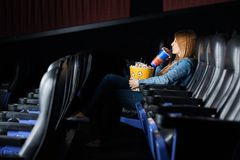 Woman Drinking Cola While Watching Movie At Stock Photo