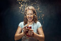 Woman drinking a cola royalty free stock images