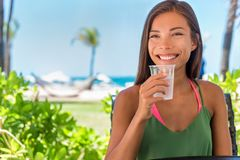 Free Woman Drinking Cold Water Drink Glass At Outdoor Cafe Hotel Resort On Beach Holidays. Healthy Girl Staying Hydrated During Warm Stock Photos - 156955133