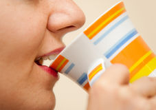 Woman Drinking from a cup Royalty Free Stock Image