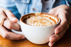 Woman drinking a cup of cappucino coffee Royalty Free Stock Image