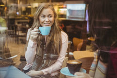 Woman drinking a cup of coffee Stock Photo