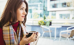 Woman drinking a cup of coffee. In cafe Royalty Free Stock Photo