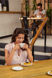 Woman drinking a cup of coffee Stock Images