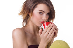 Woman drinking a cup of coffee or cappuccino Royalty Free Stock Photography