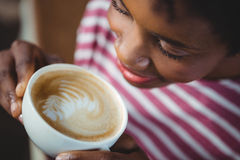 Woman drinking cup of coffee Stock Images