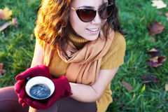 Woman drinking cup of coffee in nature Royalty Free Stock Photo