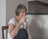 Woman Drinking Cup of Coffee. Royalty Free Stock Photo