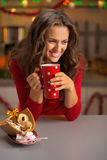Woman drinking cup of hot chocolate with cookies Royalty Free Stock Photo