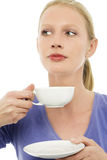 Woman drinking a cup of tea Royalty Free Stock Photos