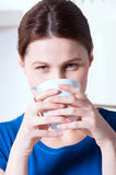 Woman drinking a cup of tea Royalty Free Stock Image
