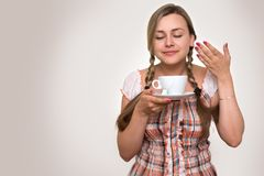 Woman drinking a cup of tea Stock Photography