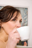 Woman drinking cup of tea Royalty Free Stock Photos