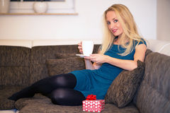 A woman is drinking a cup of tea Stock Image