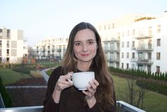Woman drinking cup tea or cappuccino royalty free stock photo