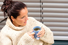 Woman drinking cup tea knitted sweater relaxing Stock Image