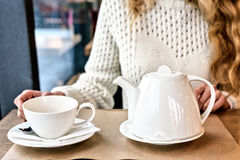 Woman drinking a Cup of tea in the restaurant. Winter leisure, cold weather, hot drink. Woman drinking a Cup of hot tea in the restaurant. Winter leisure, cold Stock Photo