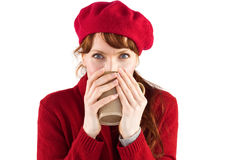 Woman drinking from a cup Stock Photo