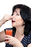 Woman drinking detox juice in disgust Royalty Free Stock Photos