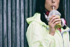 Woman drinking detox smoothie Royalty Free Stock Photos