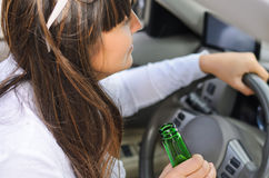 Woman drinking while driving Royalty Free Stock Photos