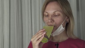 Woman drinking effervescent antipyretics pill dissolved in glass of water. Health care slow motion stock footage video stock video