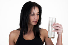 Woman drinking an effervescent tablet. In a glass Stock Photos
