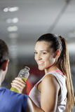 Woman drinking energy drink at the gym Royalty Free Stock Photos